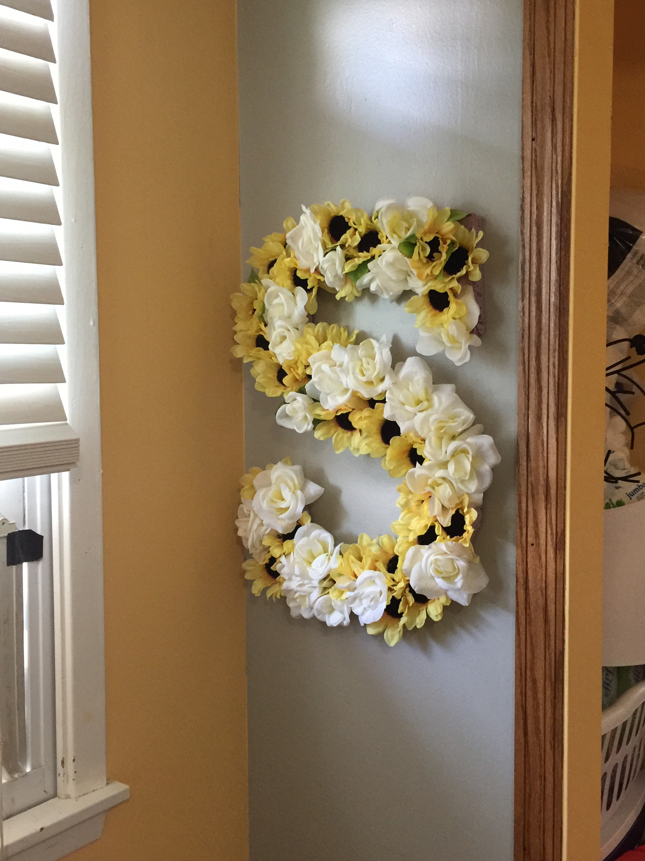 three simple steps and about one hour of my time and my cute diy floral letter was hanging on my wall let me know what you think and comment your